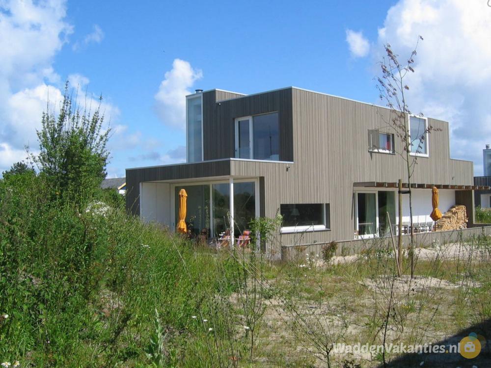 Villa in duinen bij strand en zee for Vakantiehuis bouwen
